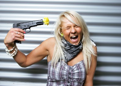 Blode_woman_with_a_plastic_gun_with_a_yellow_flower_on_the_barrel.jpg